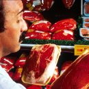 Man choosing meat in supermarket