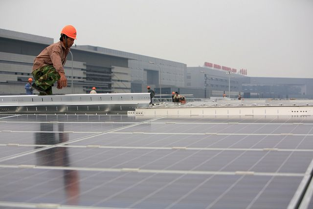 Installation of solar photovoltaic panels on the roofs of the Hongqiao Passenger Rail Terminal in Shanghai, China.