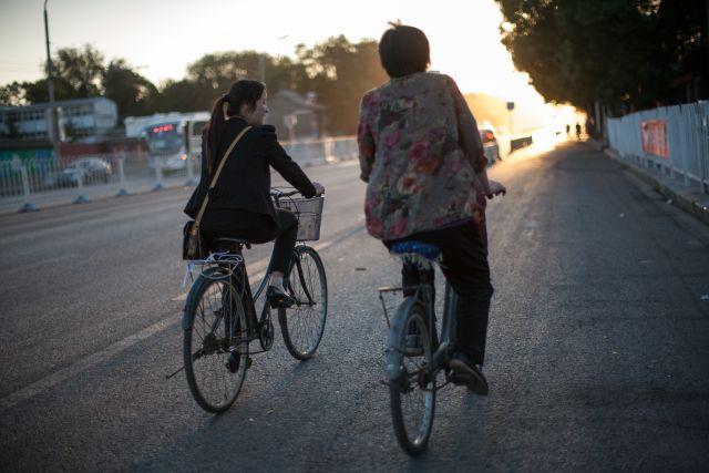 Biking in downtown Beijing