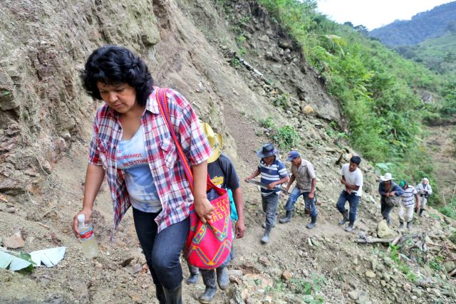 Berta Cáceres works with the people of Rio Blanco to set up a road blockade in protest of a dam.