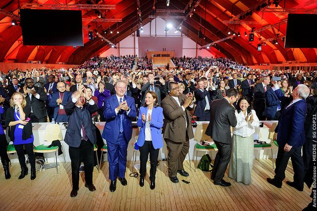 Plenary session of the COP21 after the adoption of the Paris Agreement. Photo: COP Paris/Flickr.
