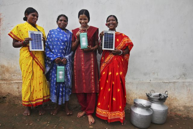 Barefoot solar engineers in Tinginaput, India. Photo by DFID/Flickr.