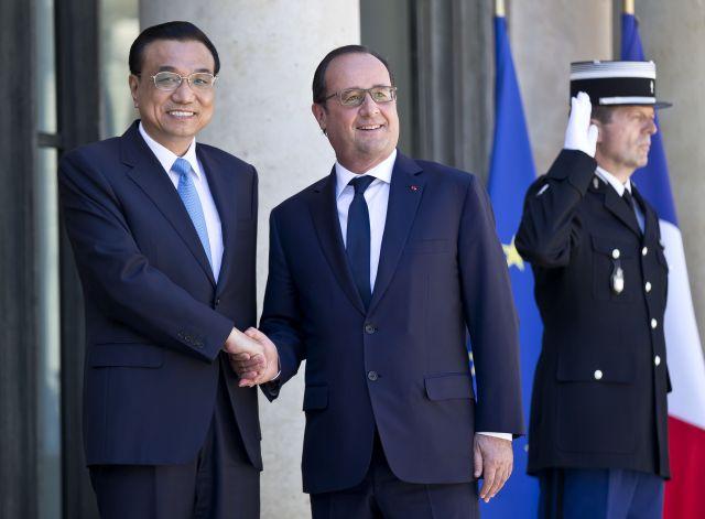 Prime Minister Li Keqiang and President François Hollande. Photo by Michel Euler/AP