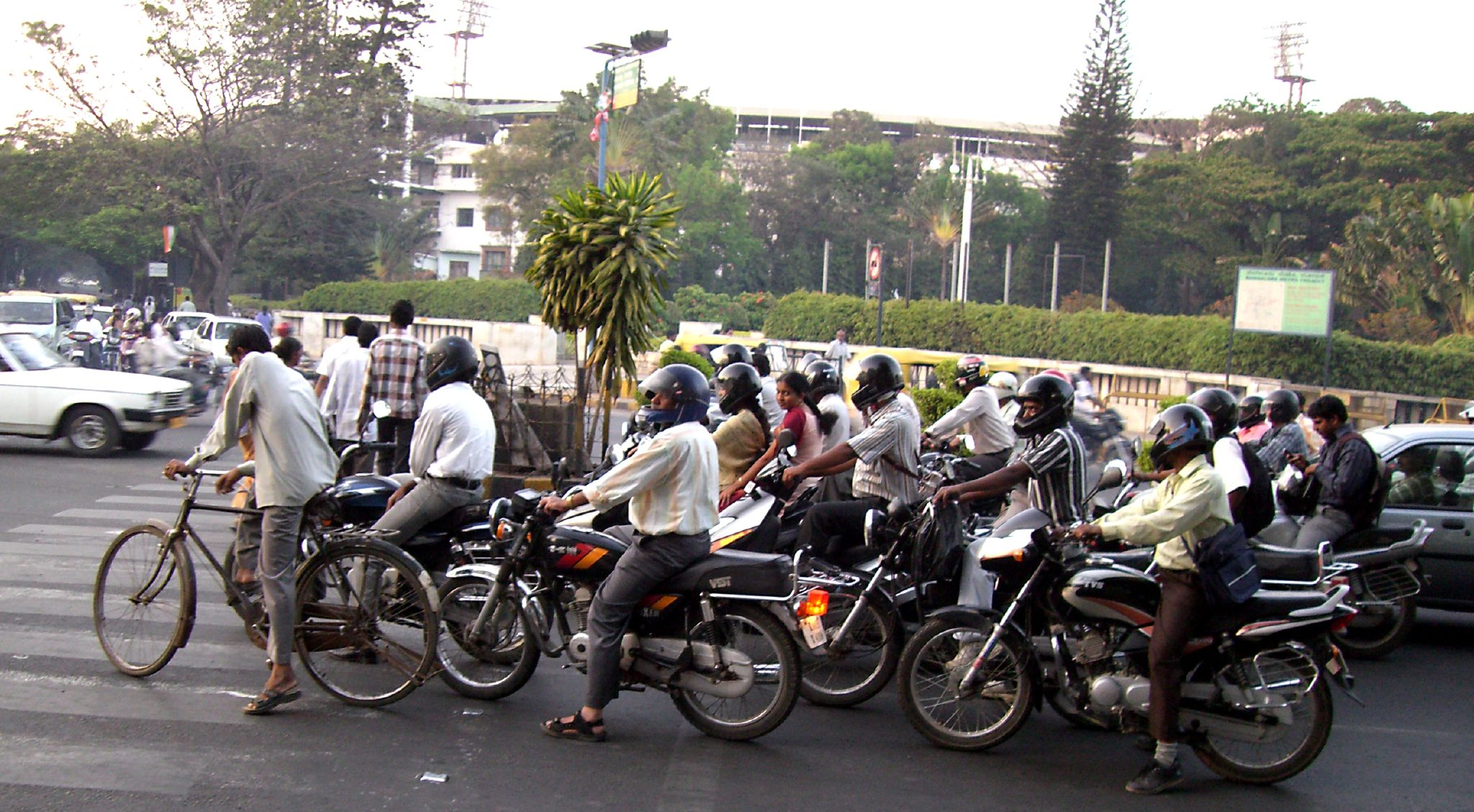 <p>A clutch of motorbikes wait for a traffic signal. Flickr/WRI Ross Center for Sustainable Cities</p>