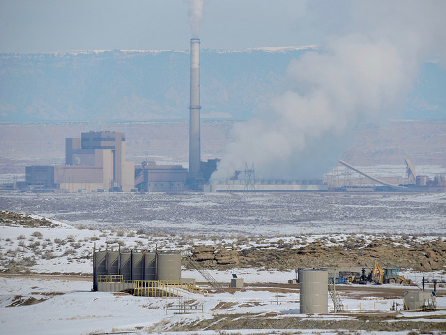 <p>Utah public lands fracking operation with coal-fired power plant. Photo by WildEarth Guardians/Flickr</p>