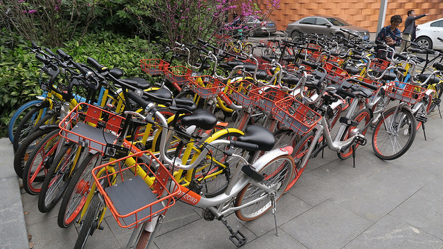<p>Many Chinese cities have become overrun with dockless bike-share bikes due to lack of regulations. Photo by David Ing/Flickr</p>