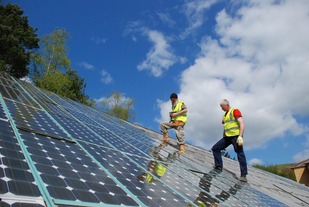 <p>Jobs installing solar are spiking. Center for Alternative Technologies/Flickr</p>