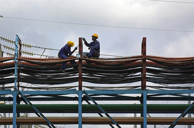 <p>Workers maintain a thermal power station at Takoradi, Ghana. Photo by Jonathan Ernst/World Bank</p>