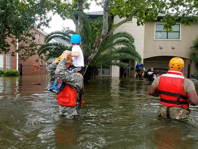 <p>Texas National Guard soldiers help citizens evacuate during Hurricane Harvey. Photo by Lt. Zachary West , 100th MPAD/The National Guard</p>