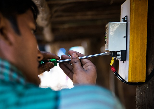 <p>Installing solar lighting. Photo by Jarnail Singh/The Climate Group</p>