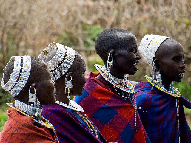 <p>Maasai women in Tanzania. Photo by William Warby/Flickr</p>