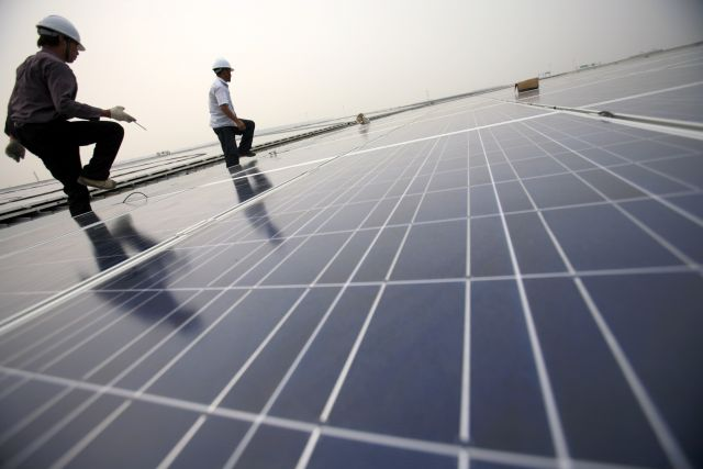Installation of solar panels in Shanghai. Flickr/The Climate Group