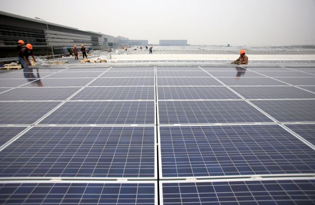 Solar PV installation at a Shanghai train station. Photo by The Climate Group/Flickr.