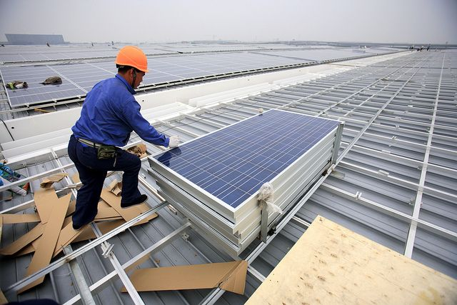 Installing rooftop solar panels in Shanghai, China