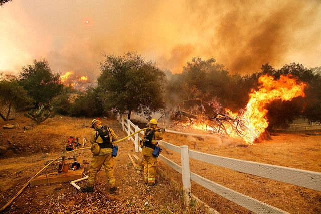 California firefighters putting out flames off of a wildfire