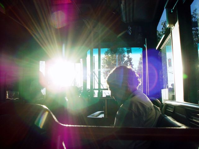 Riding the bus in Seattle. Increasing the share of passengers taking mass transit is worth more than $10 trillion. Flickr/Brian Glanz.
