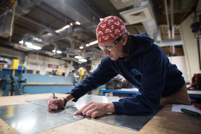 An apprentice trains for a job in energy efficiency. Flickr/EE Image Database