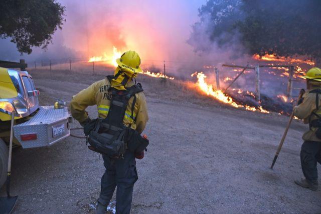 Firefighters battling California blazes. Flickr/Tony Salas