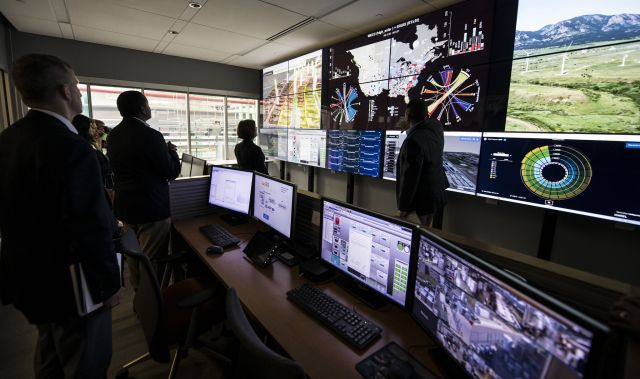 Members of Congress visit a control room at the National Renewable Energy Lab. Photo by Dennis Schroeder/NREL.