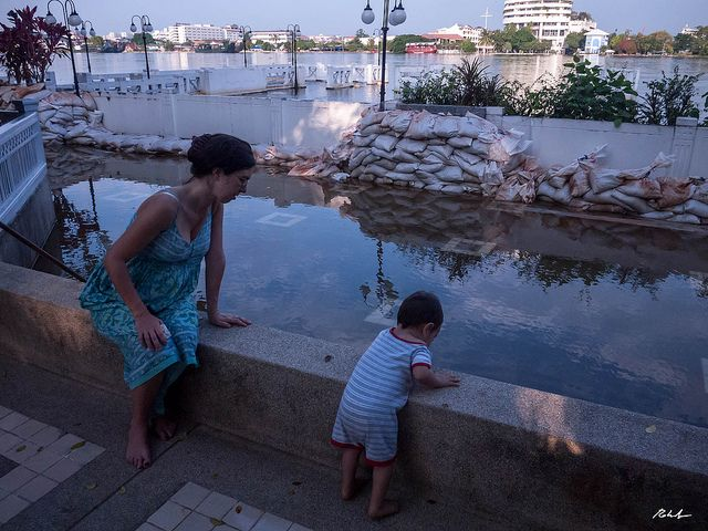 Mother and child near floodwaters