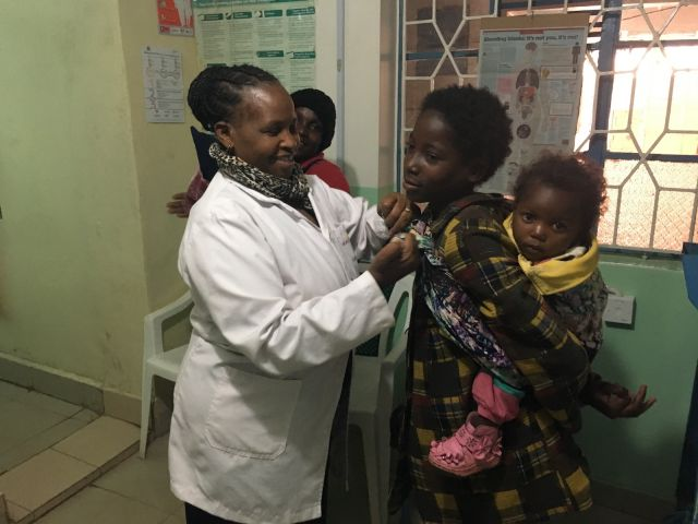 Joyce Onyino and patients at her health clinic in rural Kenya