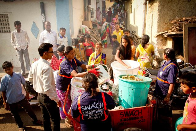 Waste collection door-to-door by the members of the SWaCH cooperative in Pune, India. Photo Credit: Brodie Talbot