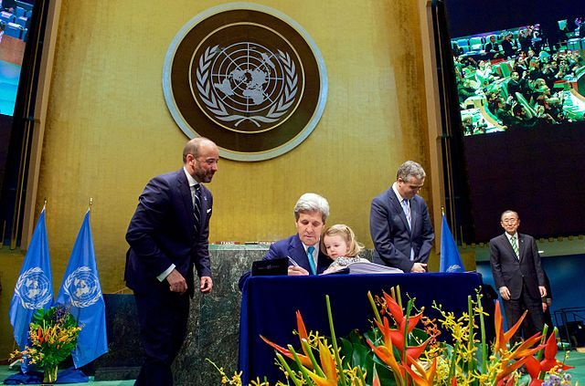 U.S. Secretary of State John Kerry signs the Paris Agreement.
