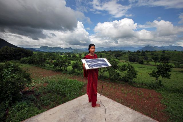 Woman in India holding solar panel