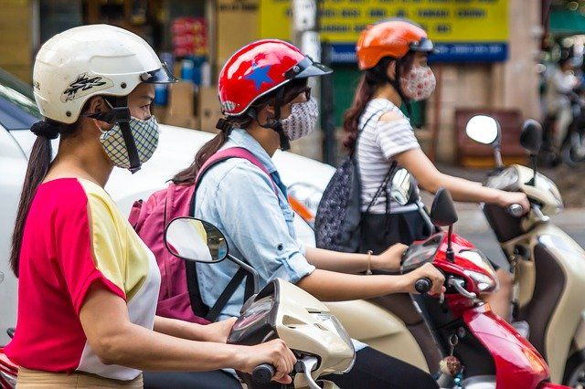 Scooter-riders with face masks in Hanoi, Vietnam
