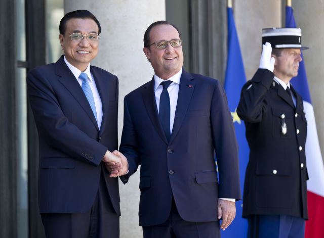Prime Minister Li Keqiang and President François Hollande. Photo by Michel Euler/AP