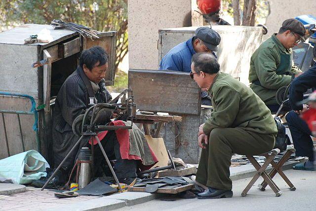 Sidewalk shoe-repair stands