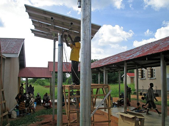 Installing solar panels in Tanzania. Photo by Solar Electric Light Fund/Flickr