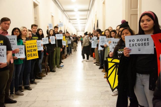 Climate activists outside House Minority Leader Nancy Pelosi's office