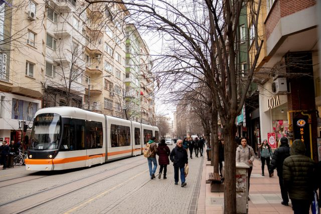 Electric tram and pedestrians on a street in Eskişehir, Turkey