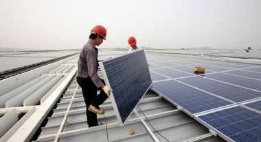 Men installing solar panels in Shanghai