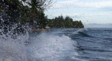 Waves crash on an atoll in the Marshall Islands. Flickr/Elizabeth Kate Switaj