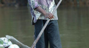 A man canoeing in Orientale, Democratic Republic of the Congo. Flickr/Julien Harneis