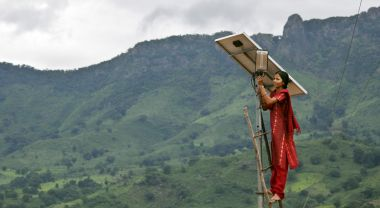 Setting up solar street lighting in Tinginaput, India. Flickr/DFID