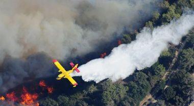 An aircraft flying over Mount Carmel