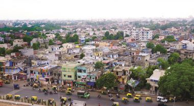 Ahmedabad uses a special process for acquiring land to make sure new developments receive city services.