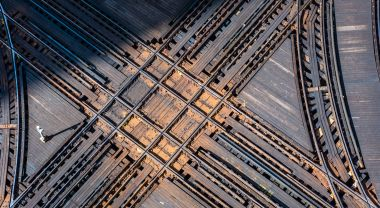 Railroad intersection from above. Projecting different future pathways can help governments come up with robust policy options. Photo by Stephen Hanafin/Flickr.
