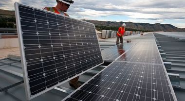 Installing solar panels. Photo by Dennis Schroeder/Department of Energy