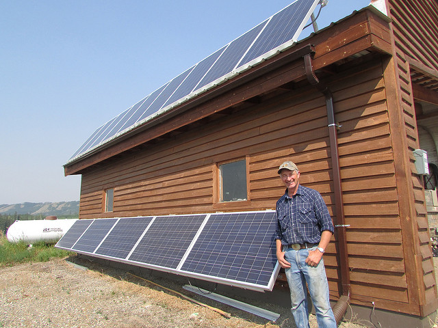 <p>This man in British Columbia has just installed solar panels on his home. Photo by DeSmog Canada/Flickr</p>