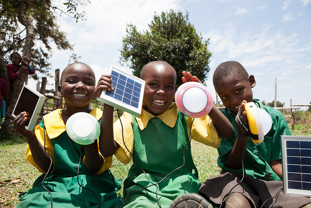 <p>School children use solar-powered lights in Longisa, Kenya. Photo by Corrie Wingate Photography/SolarAid</p>