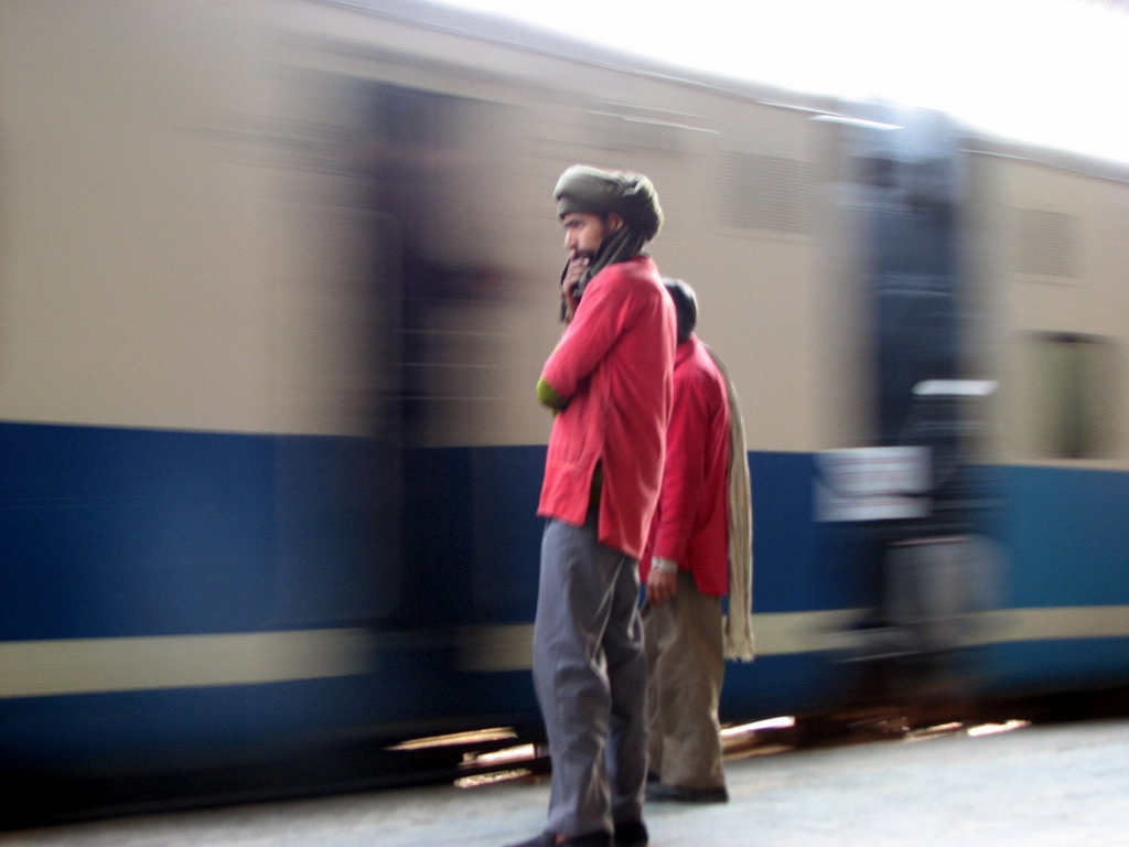 <p>Waiting on a train in New Delhi. Photo by Jasleen_Kaur/Flickr</p>