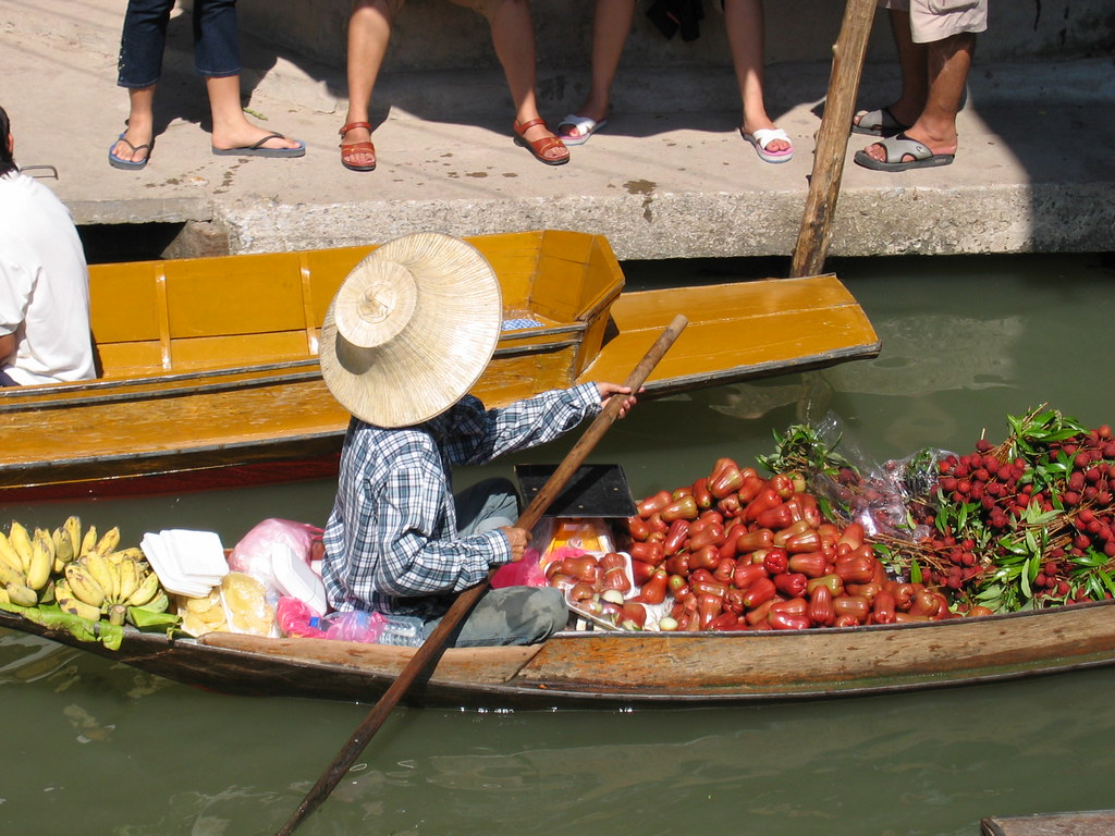 <p>Thailand farmer rows boat laden with fruit and vegetables to market. Flickr/WRI</p>