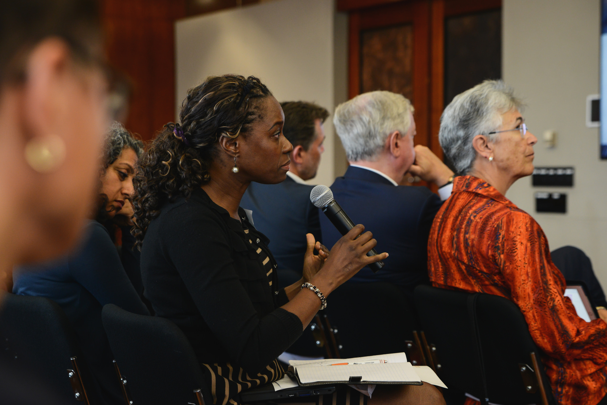 <p>Audience member at food loss and waste event. Flickr/WRI</p>