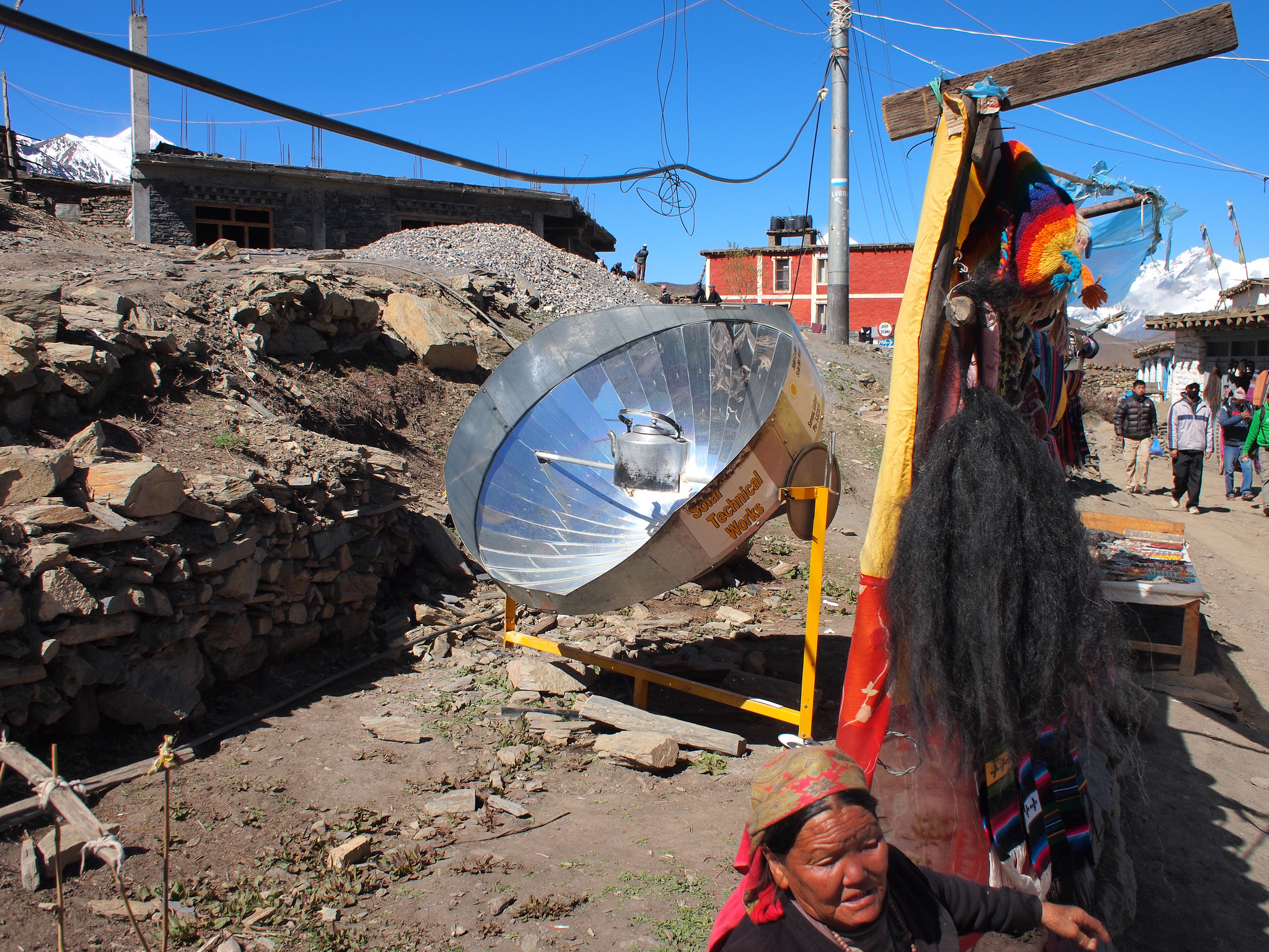 <p>Solar cooker in Nepal. Flickr/IIP Photo Archive.</p>