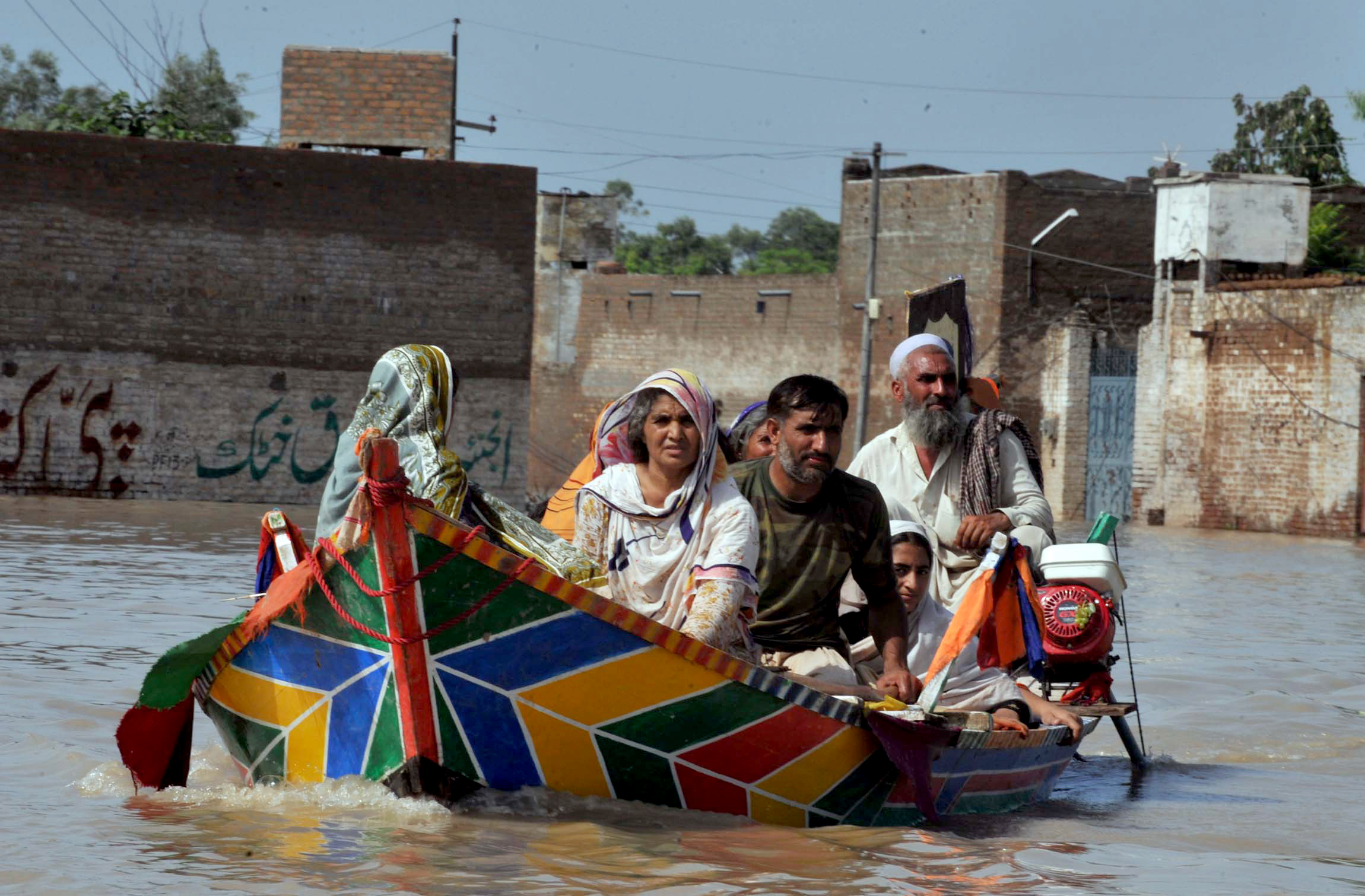 <p>Paddling away from floods in Pakistan in 2010; flash flooding in Karachi killed more than a dozen last week. Flickr/IRIN News</p>