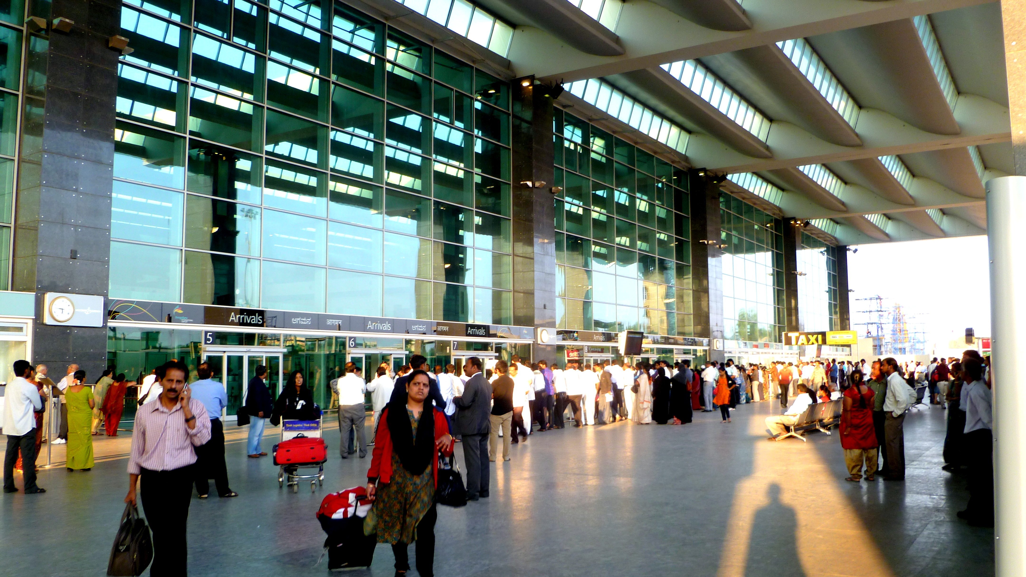 <p>Bangalore International Airport terminal, now powered by solar energy. Photo by Herry Lawford/Flickr</p>